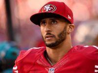فوتبالیست معروف آمریکایی به احترام سرود ملی نایستاد