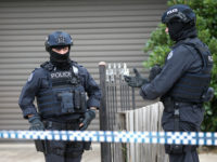Police officers that form part of the Australian Joint Counter Terrorism Team stand outside a home they raided as part of an operation in which they arrested three men who were allegedly preparing to attack the public in Melbourne, Australia, November 20, 2018.  AAP/David Crosling/via REUTERS