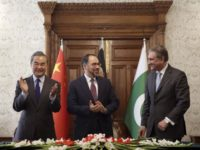 Afghanistan's Minister of Foreign Affairs Salahuddin Rabbani, center, Pakistan's Foreign Minister Shah Mehmood Qureshi, right, and Chinese Foreign Minister Wang Yi clap after signing the agreement during a meeting at the presidential palace in Kabul, Afghanistan, Saturday, Dec. 15, 2018. Afghanistan, Pakistan, and China are meeting in the Afghan capital to discuss trade, development and ending the region's relentless conflicts. (AP Photo/Massoud Hossaini
